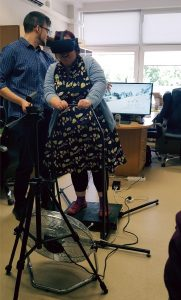 Cate Lawrence tries out the VR system created by KTU student